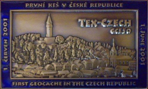 Tex-czech: Geocoin s motívom prvej českej dodnes aktivnej kešky
